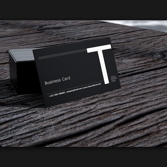 Blank business card on old dark wood selective focus