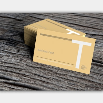 Blank business card on old dark wood
