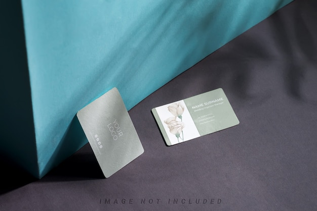 Blank business cards on duotone background with shadows