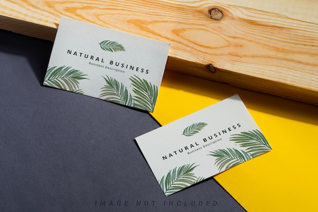 Blank business cards on duotone and wooden background