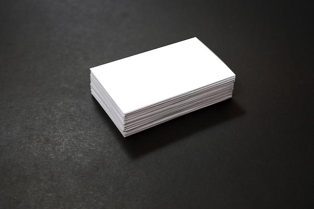 Blank business cards stack mockup on black background