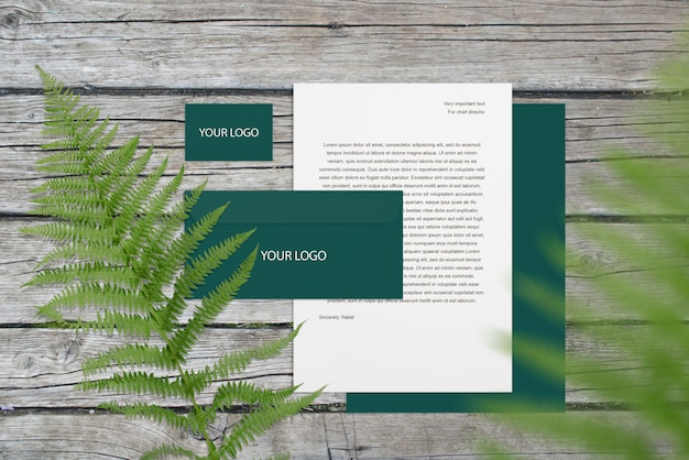 Blank corporate mockup stationery set on wood