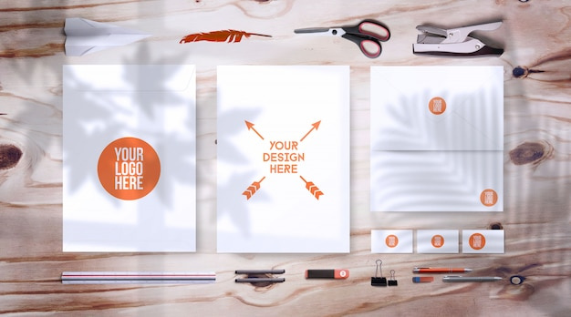 Blank corporate stationery set on wooden table