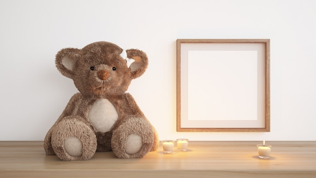 Blank frame with teddy bear and candles