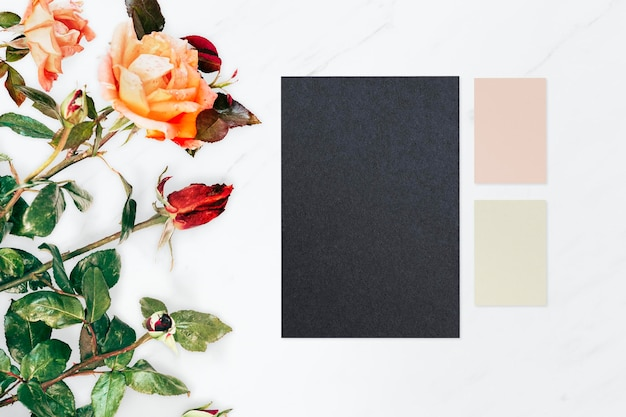 Blank notepapers on marble background mockup