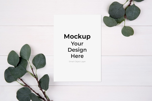 Blank paper sheet copy space with mockup and leaf on wooden table