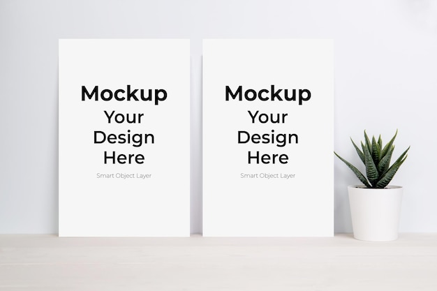 Blank paper sheet mockup and plants on wooden table