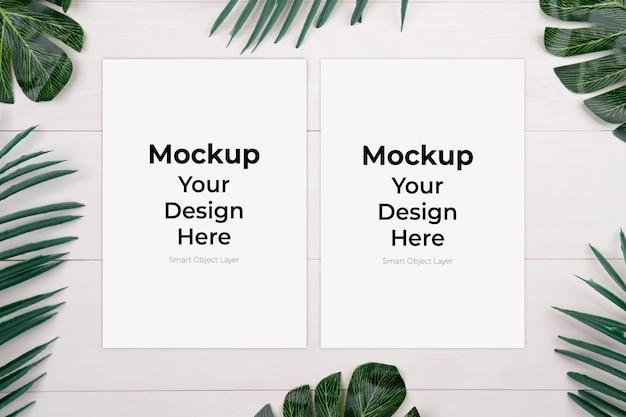 モックアップと木製のテーブルの葉と空白の紙シート