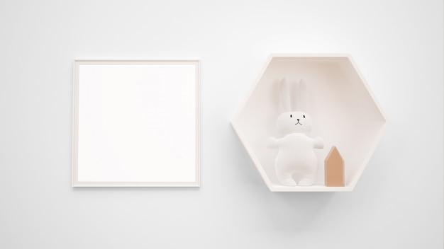 Blank photo frame mockup hanging on the wall next to a bunny toy