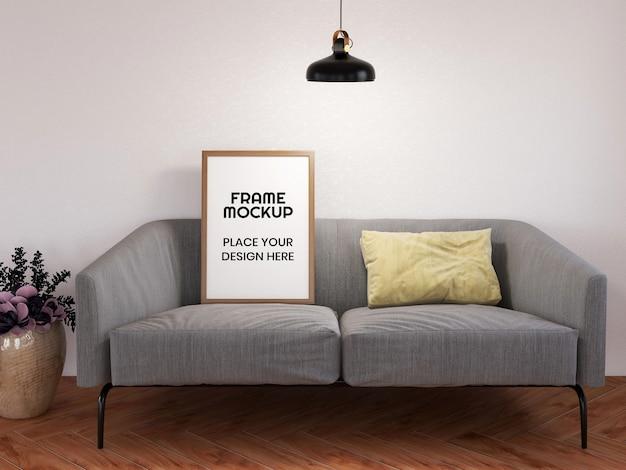 Мокап пустой фоторамки на минималистском диване