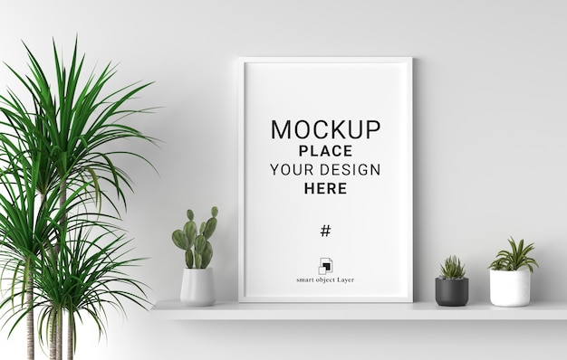 Blank photo frame mockup with plant in white wall background.