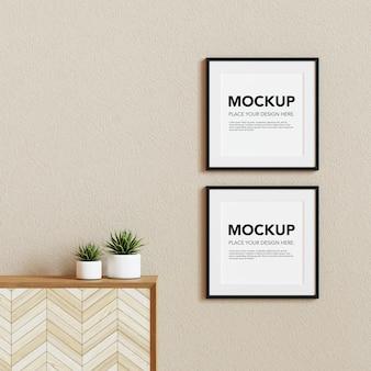 Blank photo frames mockup on the wall