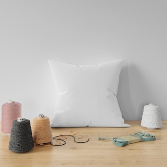 Blank pillow on wooden table