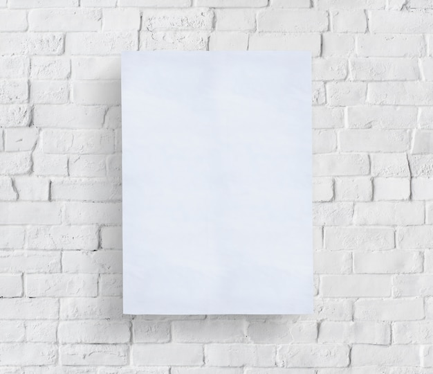 Blank poster in front of brick wall