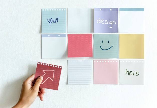 Blank sticky notes on a wall