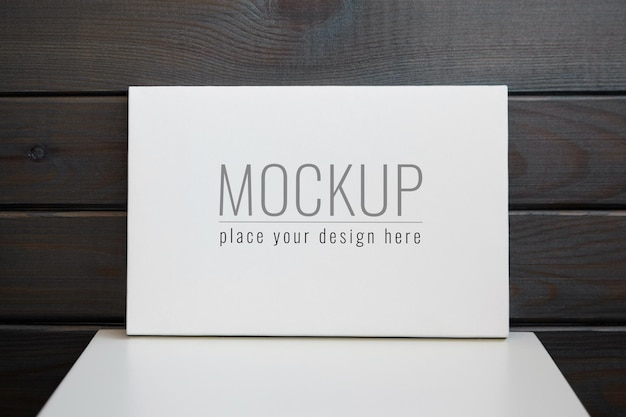 Blank stretched canvas mockup on white table