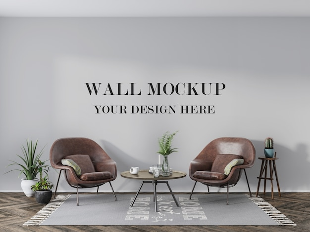 Blank wall behind leather armchairs