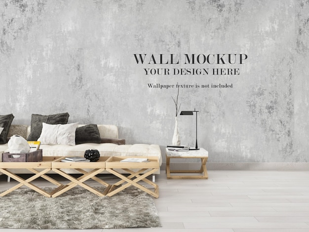 Blank wall mockup behind modern blue sofa