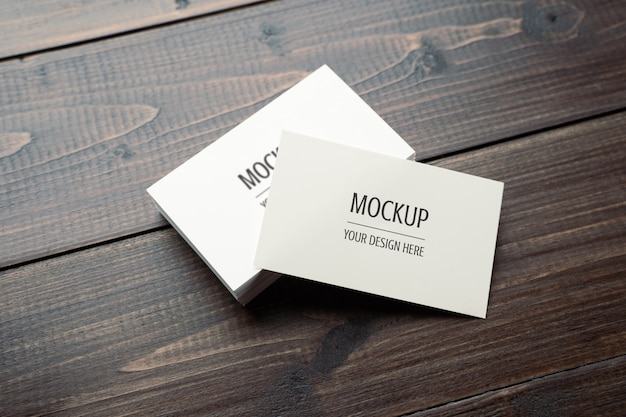 Blank white business card mockup psd on wood table