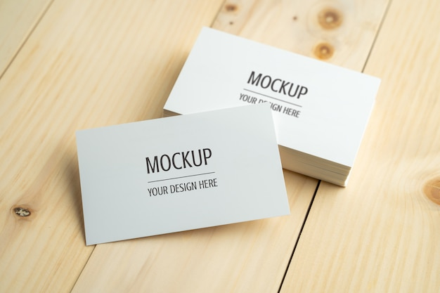 Blank white business card on wood table
