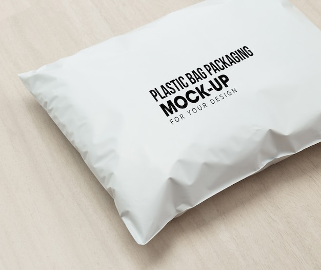 Blank white plastic bag package mockup template on wooden background.