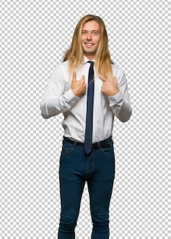 Blond businessman with long hair with surprise facial expression