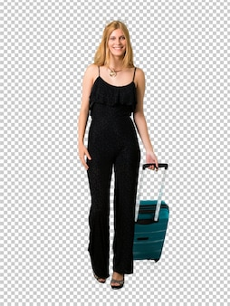 Blond girl traveling with her suitcase walking. motion gesture.
