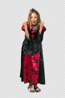 Blonde child dressed as a vampire for halloween holidays annoyed angry in furious gesture