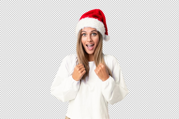 Blonde girl with christmas hat celebrating a victory