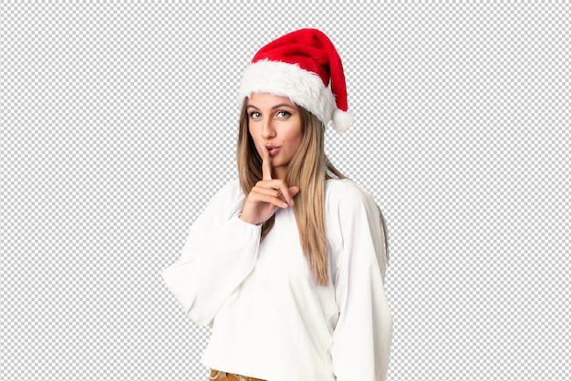침묵 제스처를 하 고 크리스마스 모자와 금발 소녀