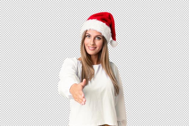 좋은 거래 후 크리스마스 모자 핸드 쉐이킹 금발 소녀