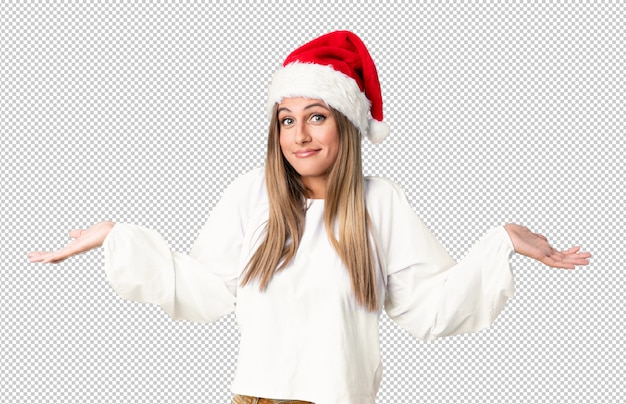 Blonde girl with christmas hat having doubts with confuse face expression