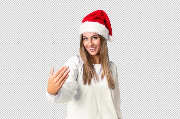 Блондинка в новогодней шапке приглашает прийти