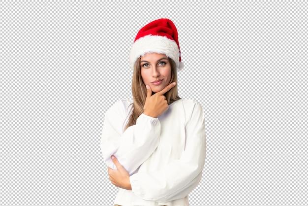 크리스마스 모자 웃 고있는 금발 소녀