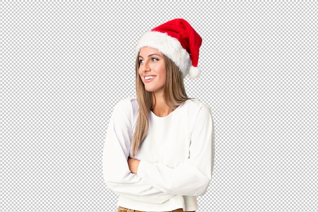 Blonde girl with christmas hat laughing
