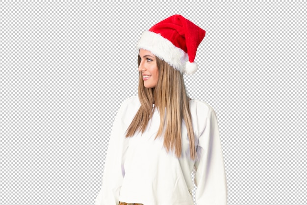 Blonde girl with christmas hat looking to the side