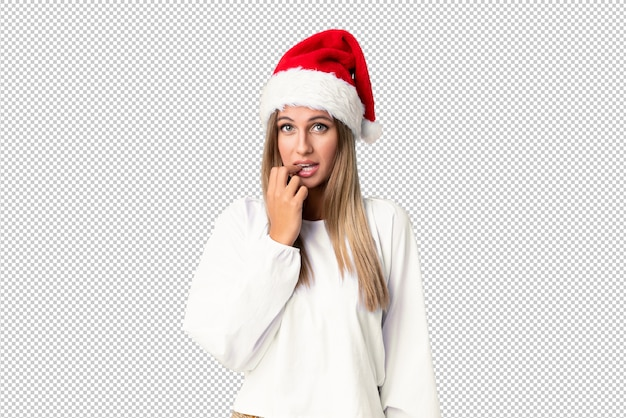 Blonde girl with christmas hat nervous and scared