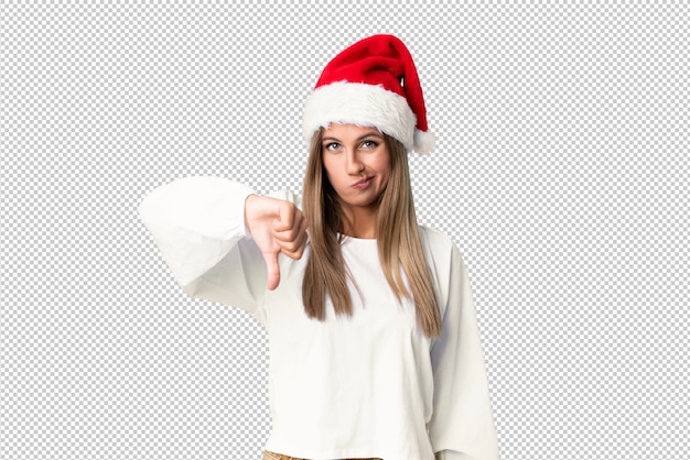Blonde girl with christmas hat showing thumb down sign