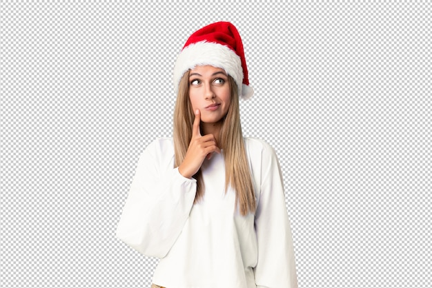 아이디어를 생각하는 크리스마스 모자와 금발 소녀
