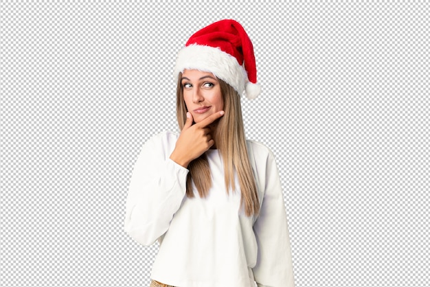 Blonde girl with christmas hat thinking an idea