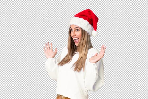 놀라운 표정으로 크리스마스 모자와 금발 소녀