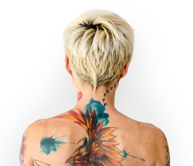 Blonde woman with a colorful back tattoo