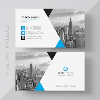 Blue and white business card with photo of city