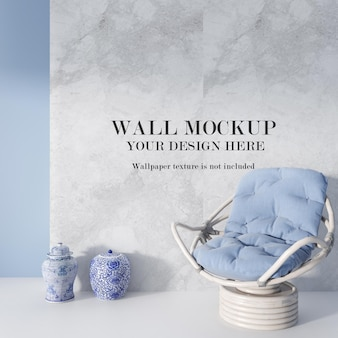 Blue color rattan armchair in front of mockup wall