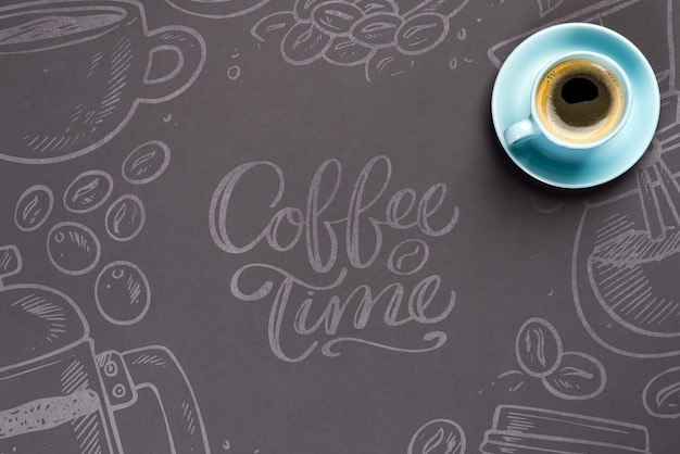 Blue cup of coffee over the black paper with copy space mockup