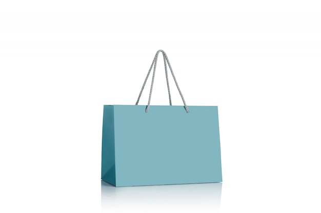 Blue paper shopping bag isolated.