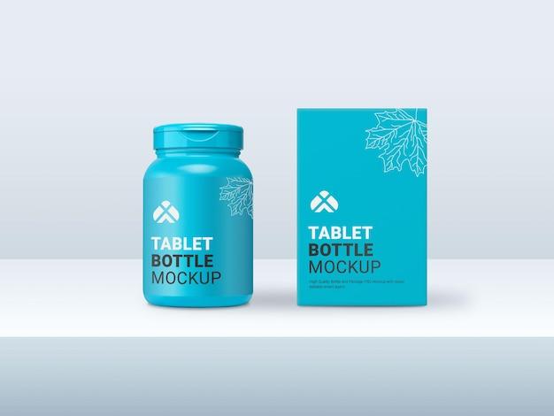 Синяя бутылка для таблеток с макетом прямоугольной картонной упаковки