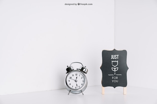 Board and alarm clock in corner