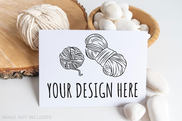 Boho horizontal postcard mockup with white yarn on a white table background. rustic bohemian image. space for text. good for macrame and handicrafts banners and advertisement. copyspace mock up