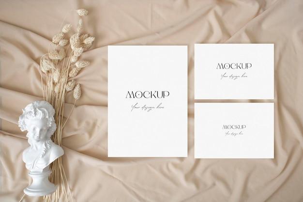 Boho wedding suite mockup with eucalyptus on the nude fabric background